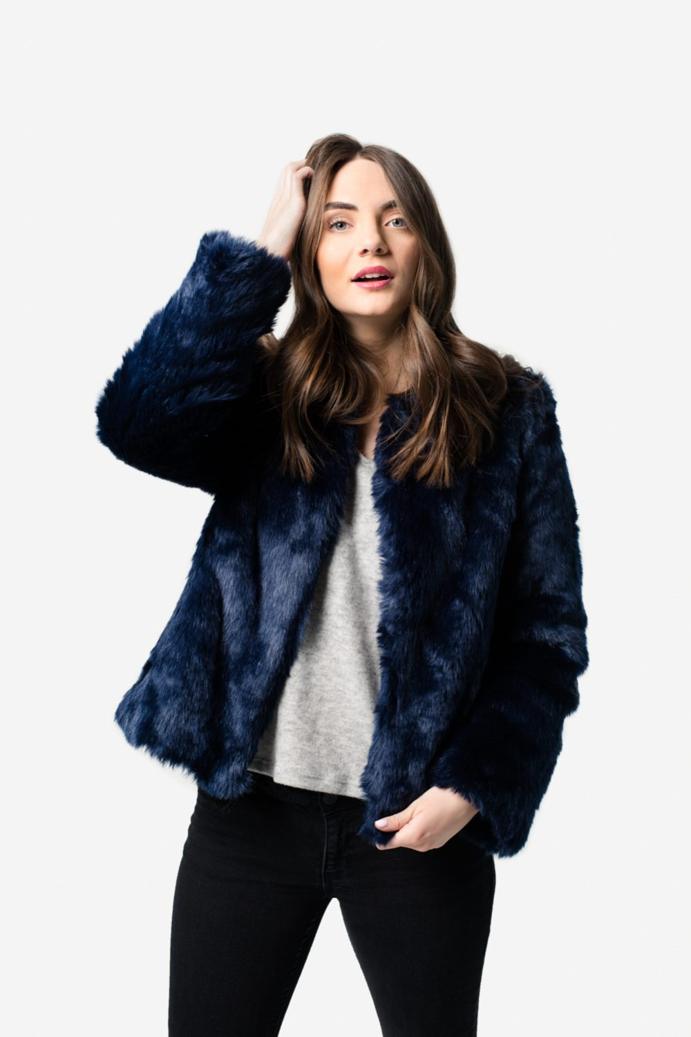 Utah Fashion Photographer Stylist Brunette Model Jumper Grey Navy Studio Lighting Fur Coat Black Pants Model BYU